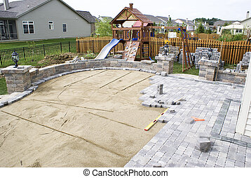Paving patio on to levelled sand. Backyard Project.