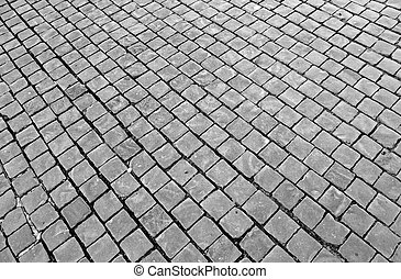paving with cobblestones in St. Peter's square at the ...