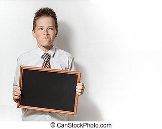 Pawky boy with empty chalkboard