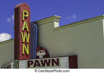 Pawn Shop Entrance - A vintage pawn shop sign above the...