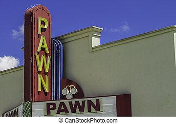 Pawn Shop Entrance - A vintage pawn shop sign above the...