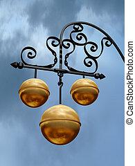 Pawnbroker Shop - Pawnbroker shop sign with three golden...