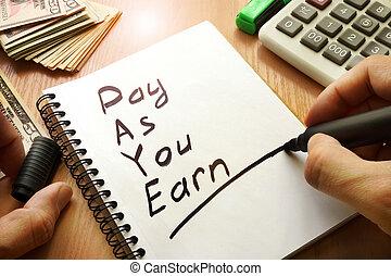 Pay As You Earn – PAYE written in a note.