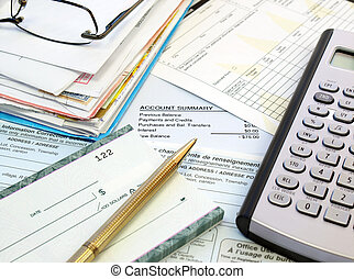 Pay Bills - A pile of bills, checkbook, pen and calculator...