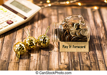 Pay it Forward money jar motivational concept
