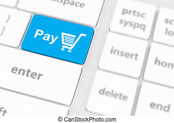Pay key with shopping cart icon on a white keyboard