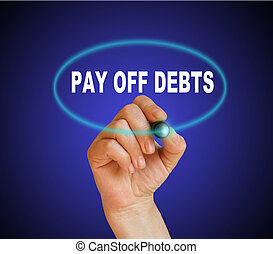 Pay off debts - writing word Pay off debts with marker on...