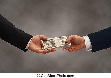 Pay-Off - Two hands of businessmen passing a stack of...