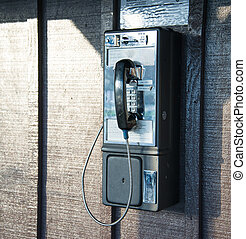pay phone on wall of building