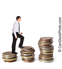 Pay raise - A young businessman walking up several pile of...