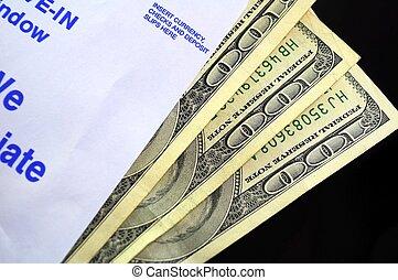 Payday - Bank envelope showing one hundred dollar bills.