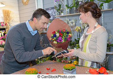 paying at the flower shop