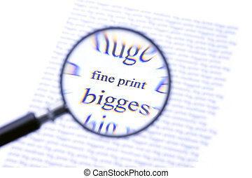 Paying attention to the fine print - A magnifying glass,...