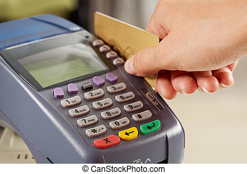 Paying by card - Close-up of payment machine while human...