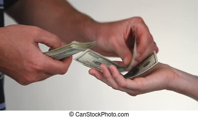 Paying Cash - Close up of paying cash from man\'s hands...
