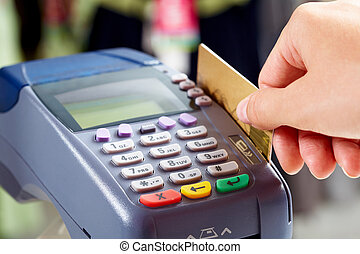 Close-up of female hand doing purchase through payment machine