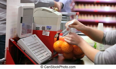 Paying for goods - Customer paying for products at checkout...