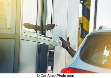 Paying Highway Toll. Men in the Car Paying the Toll. Highway...