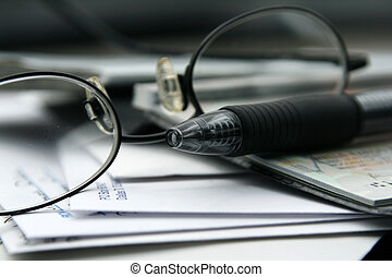 Paying the Bills with Checks - Close up on the Glasses and...