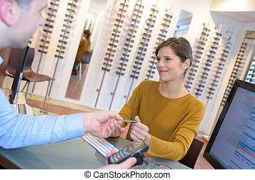 paying the eyeglasses