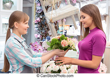 Paying with credit card at florist shop - This bouquet is a...