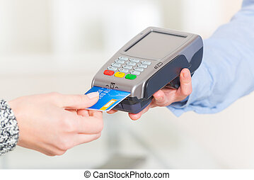 Paying with credit or debit card in wireless payment...