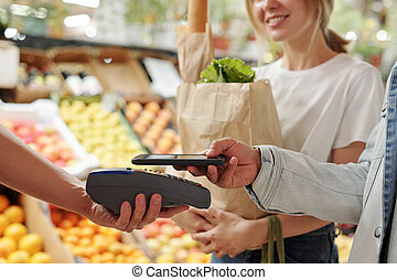 Paying with smartphone at market