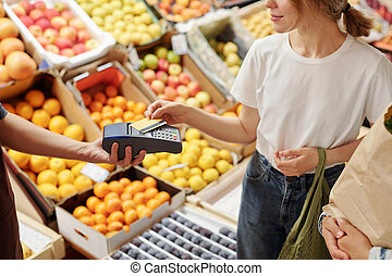 Paying with wireless card at farmers market