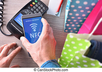 Payment in a trade with phone nfc system top view