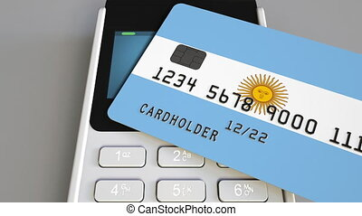 Payment or POS terminal with credit card featuring flag of Argentina. Argentinian retail commerce or banking system conceptual animation