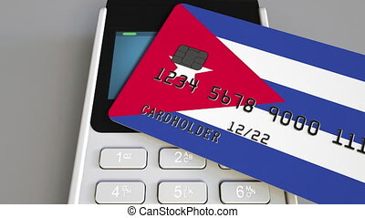 Payment or POS terminal with credit card featuring flag of Cuba. Cuban retail commerce or banking system conceptual animation