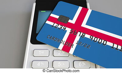 Payment or POS terminal with credit card featuring flag of Iceland. Icelandic retail commerce or banking system conceptual animation