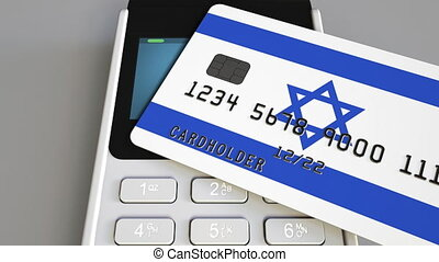 Payment or POS terminal with credit card featuring flag of...
