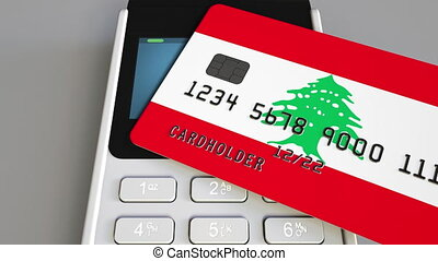 Payment or POS terminal with credit card featuring flag of Lebanon. Lebanese retail commerce or banking system conceptual animation