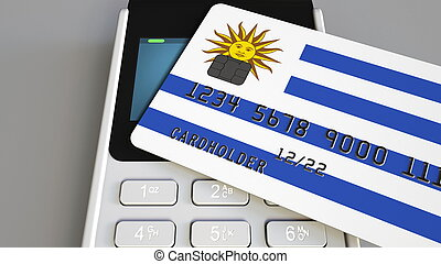 Payment or POS terminal with credit card featuring flag of Uruguay. Uruguayan retail commerce or banking system conceptual 3D rendering
