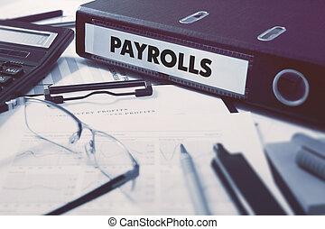 Payrolls on Ring Binder. Blured, Toned Image.