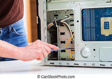 Pc repair - Computer specialist use screwdriver to repair...