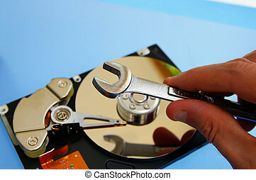 PC technician repairing a  computer hard-drive