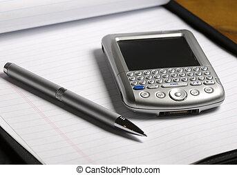 PDa Computer & Pen on a Notebook
