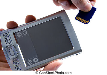 PDA - Paml with hand inserting SD card