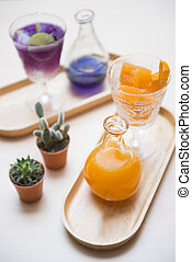 pea flower water and orange juice set for drink