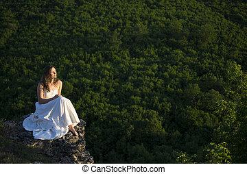 Peace and greenery - Beautiful young woman wearing elegant...