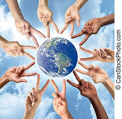Concept of peace and multiracial with hands. World provided by Nasa