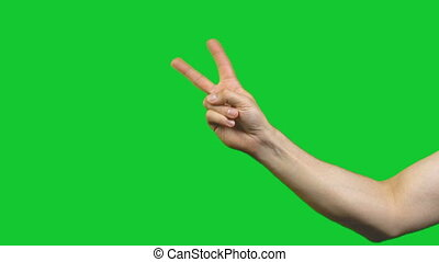 Peace gesture on green background - Footage of male hands on...