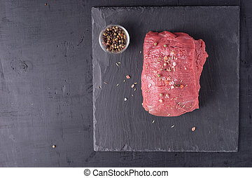 Peace of beef fillet for steak on slate plate