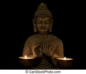 Peace of mind - budha with two candles on a black background