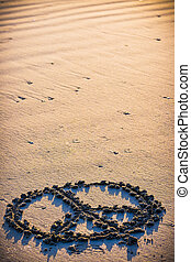 Peace Sign Drawn in the Sand