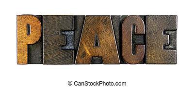 The word PEACE written in vintage letterpress type
