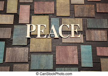 Wooden letters forming word PEACE written on wooden background