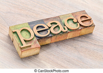 peace word abstract in wood type